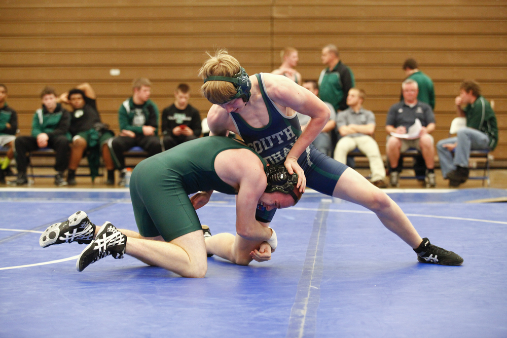 South Oldham's Max Knabel duel's Trinity High School's Jacob Miles in the 145-pound weight class. Miles went on to win the match by pin.