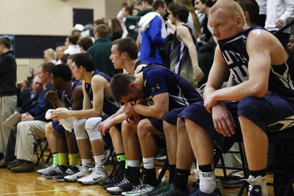 South Oldham forward Drew Horsey, right, and his teammates look on as North Oldham beat south 76-63.