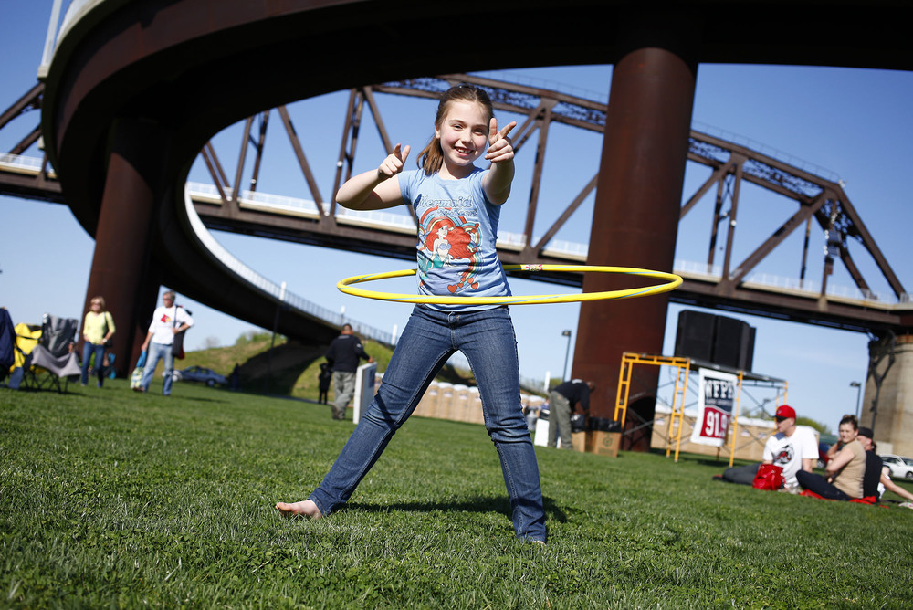 Charlotte Glaab, 8 of Louisville, hula-hoops in front of the Big Four Bridge before the start of the first Waterfront Wednesday of the summer.
