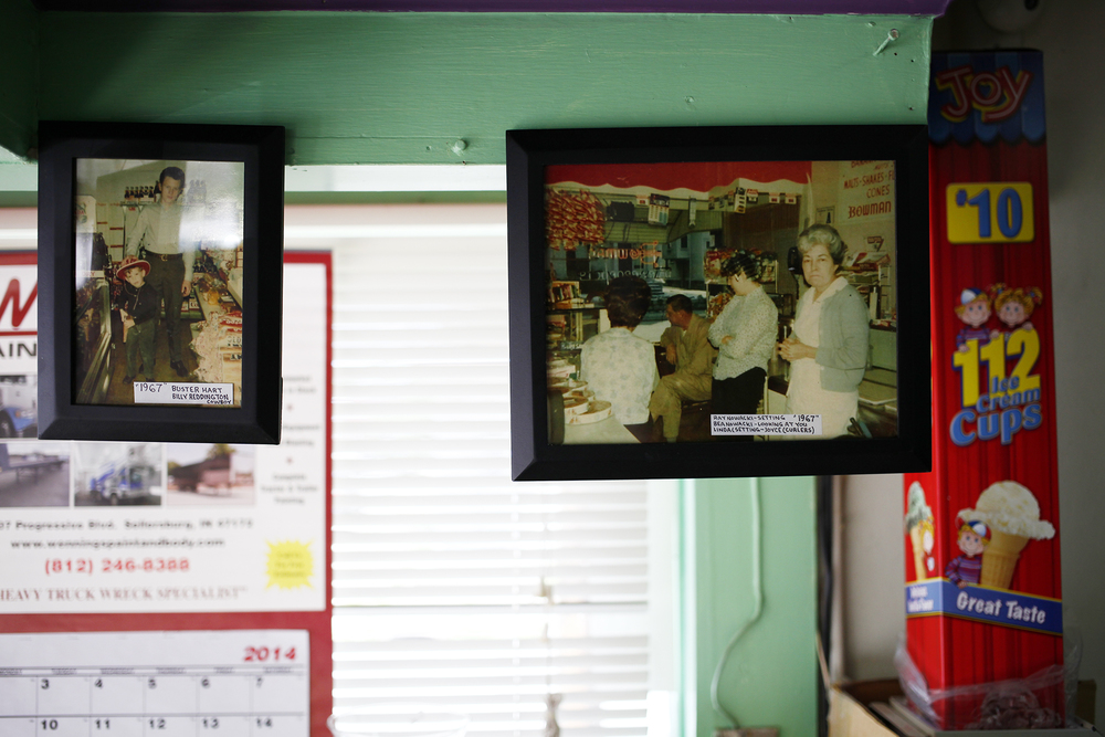 Images of former owners and customers hang in the In-and-Out Dairy Mart on Portland Avenue.