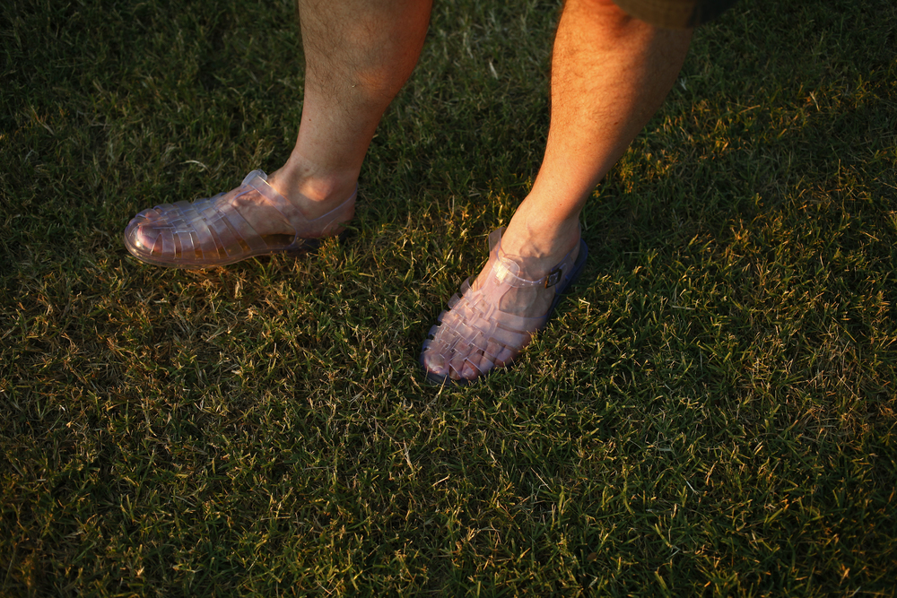 Charlie Wellock, of Philadelphia, Pa., wears size 11 jelly sandals he purchased at the festival five years ago.