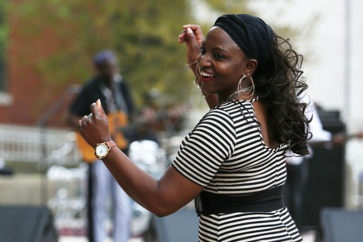 A woman dances to Oliver Mtukudzi, a Zimbabwean musician, at Jefferson Community and Technical College.