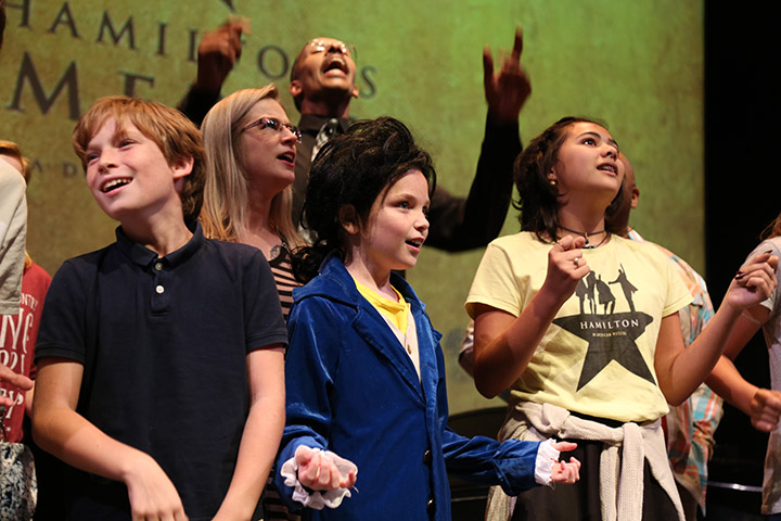Youth sing along to songs from Hamilton.