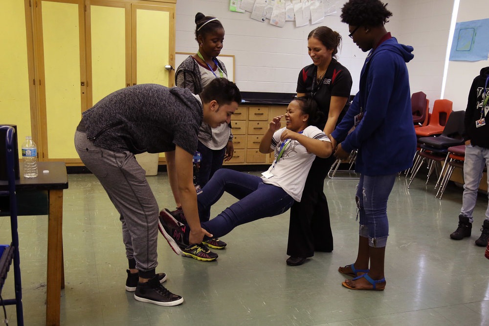 Students at ESL Newcomer Academy work on making shapes with dance and theater organization, Pilobolus.