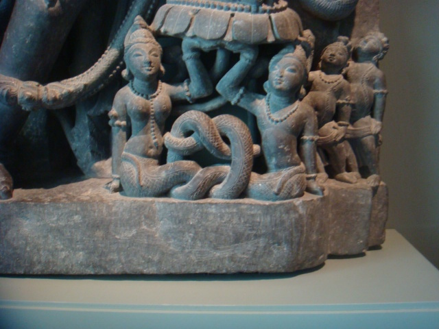 I liked the way that these two serpent people, a man and a woman, had their tails wrapped around and holding each other tenderly. You can't see it, but they are holding up a foot of a deity 20 times larger than they are.