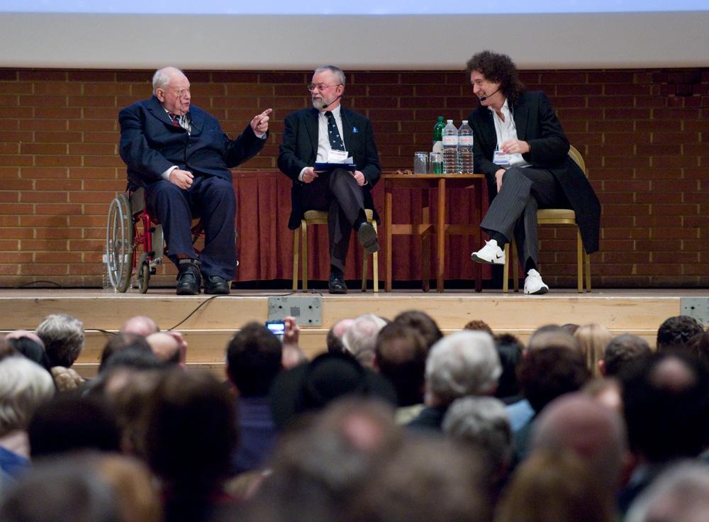 Patrick's point amuses conference chairman Iain Nicolson and Brian May. Photo: Max Alexander.