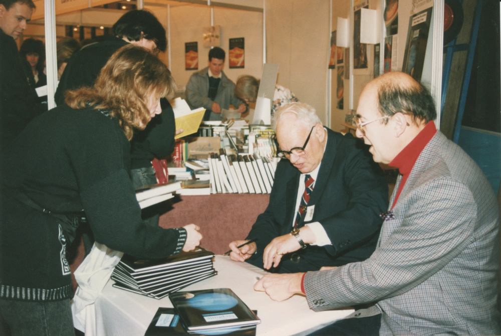 Patrick and Garry Hunt sign books in the exhibition area.