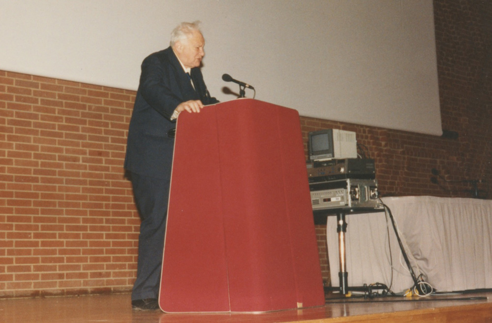 Patrick speaks at the 1994 conference. Note the audio-visual equipment – no Powerpoint presentations back then!