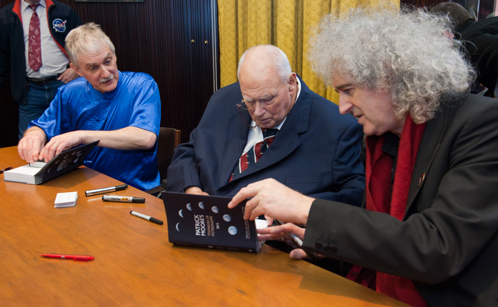 Patrick joins John Mason and Brian May for a book signing in 2012, which was sadly to be his last appearance at AstroFest. Photo: Max Alexander.