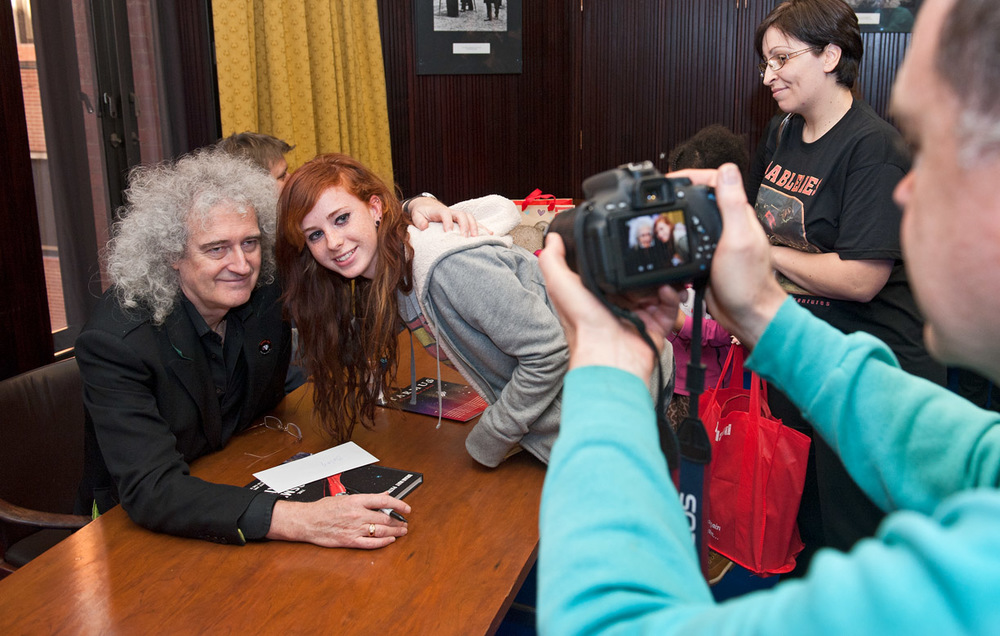 Brian May signs visitors' books at a previous European AstroFest. Photo: Max Alexander.