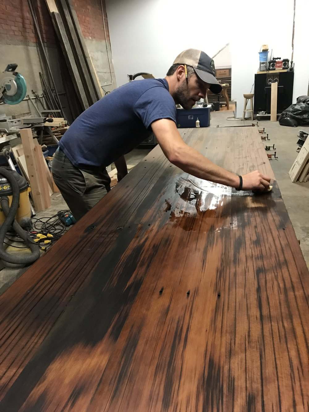 Tim applying the first coat of Danish oil to the redwood.