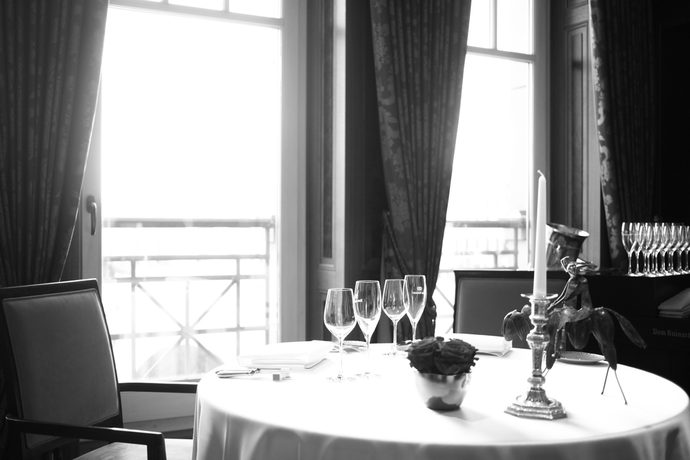 Berlin Germany. Between shoots at the Adlon, I saw the table setting kind of glowing as the sun was getting lower in the sky. I haven't shot in BW regularly for a year or two but I saw this and knew I wanted to shoot it without color. The luminosity was just right and it was a elegant outtake during my day.