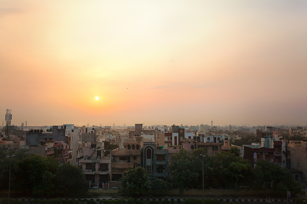 Tired morning. 4AM morning shoot of a lobby complete, I saw the sun coming up over Delhi. Pollution does makes some impressive colors... Travel is getting tiresome. In the mood for a sandwich and a root beer on my own couch.