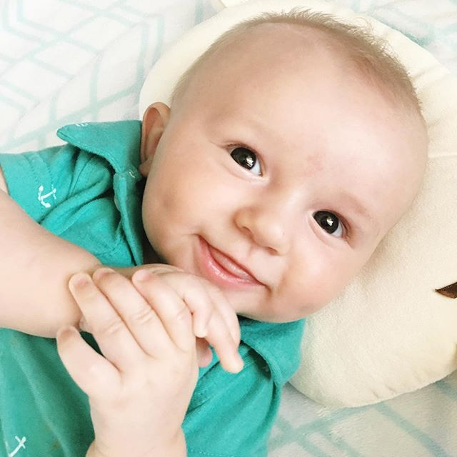 This little man is 4 months old!  He laughs and smiles all day long and is growing like a weed!  We all love him so much!