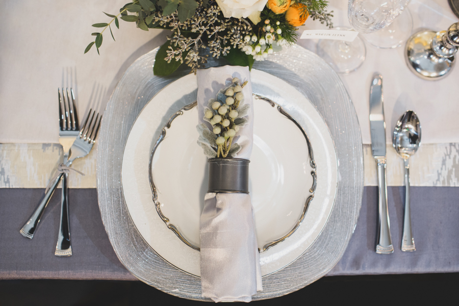 I am SO obsessed with this place setting. Metal, leather tied forks, a little sparkle, lots of linens, a unique place card idea, and super for flowers.love.