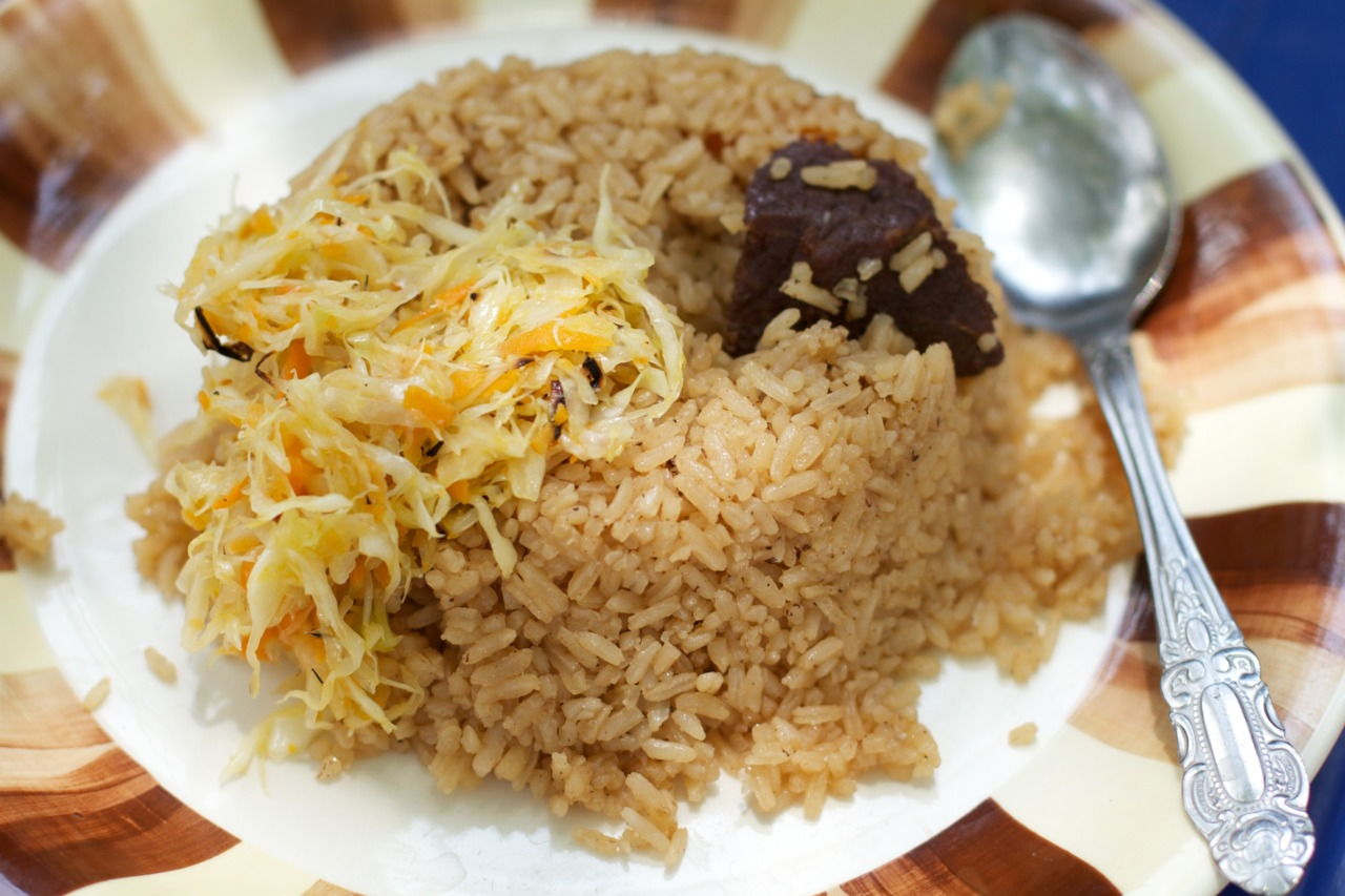 Pilau. When meat is served, you often only get 2-3 pieces. At 1500 Tanzanian Shilling (roughly 93 cents) it's not too bad a deal. However, you do need to chew carefully and be wary of small shards of bone. Photography by Dave Houldershaw