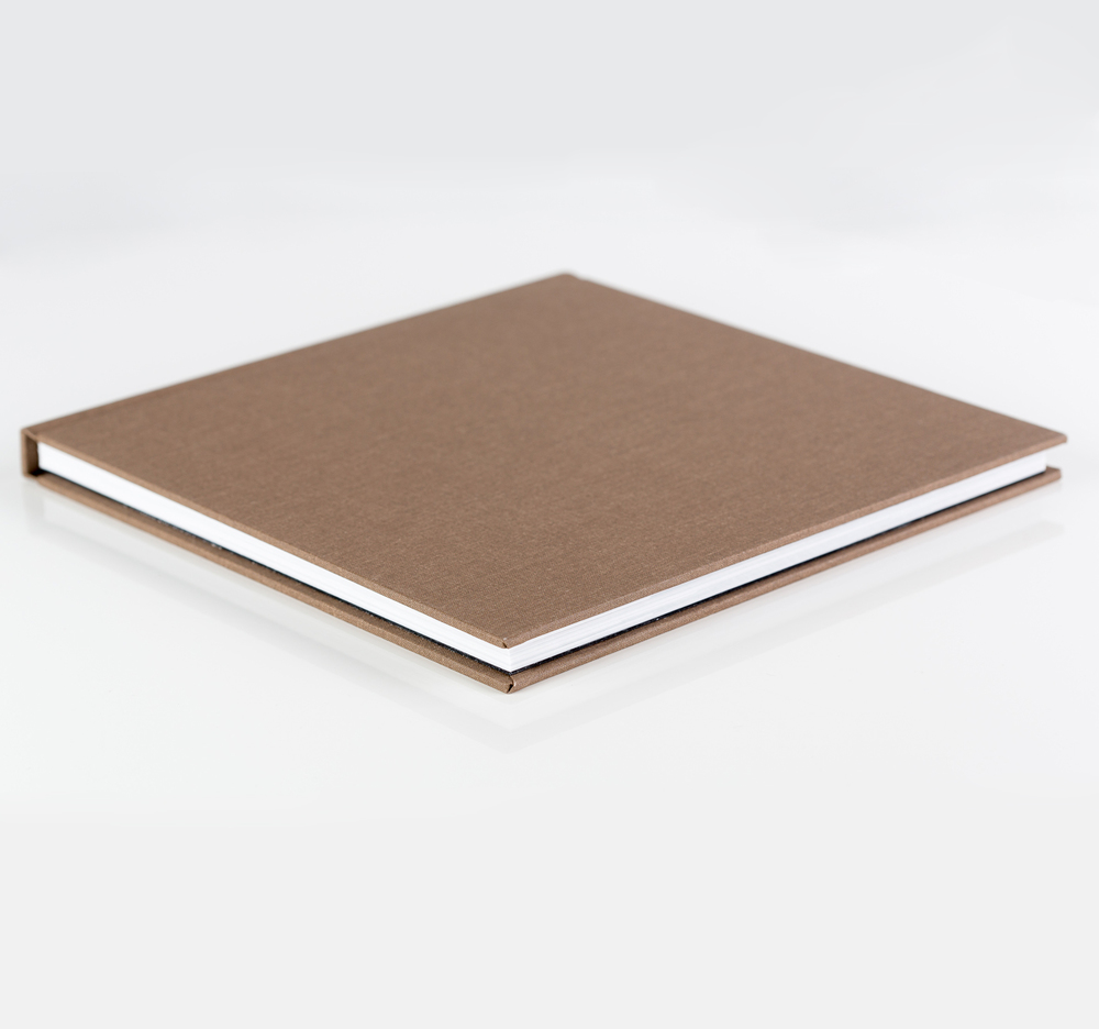 Printed on photographic paper (not magazine print). Linen covered albums are thinner, missing the hard substrate between pages that the leather albums have.  A standard album comes with 10 spreads (20 pages). Additional spreads can be added at an extra cost. Available in 8x8, 10x10, 12x12 inch sizes.