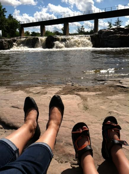 Relaxing by the Big Sioux falls at Falls Park, Sioux Falls, SD by Miranda B.