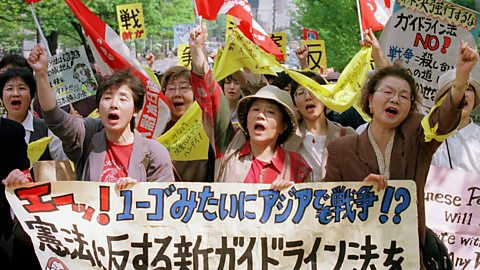 Photo: Japanese protestors against security guidelines. Credit: Associated Press