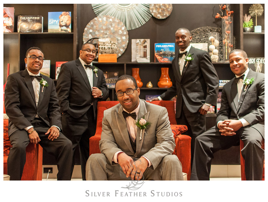 Groomsmen pose handsomely in the Conshohocken Marriott Hotel.