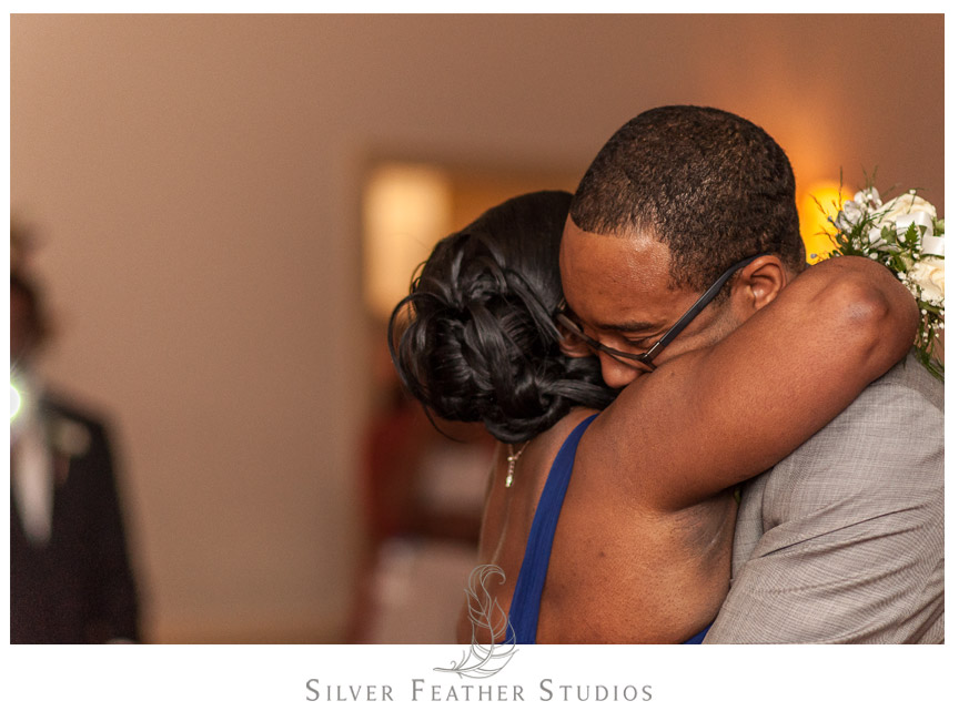 Mother and son hug at the Spring Mill Ballroom. Photo by Conshohocken Wedding Photographer.