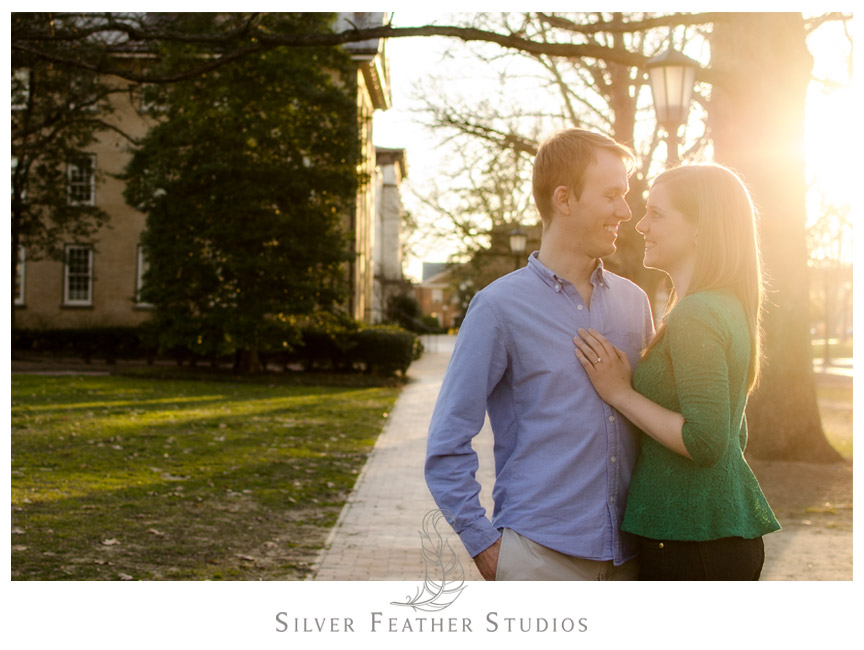 Beautiful sunset behind Kelly and Hugh at their UNC Chapel Hill engagement. © Silver Feather Studios, Chapel Hill Wedding Photography & Videography