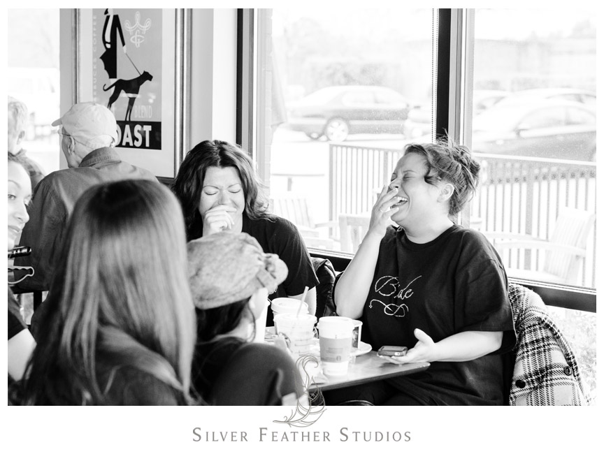 Kim laughing with her bridesmaid at Starbucks in Holly Springs North Carolina.