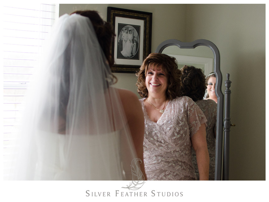 Mother of the bride looks with pride at Kim in her Vera Wang Wedding Dress.