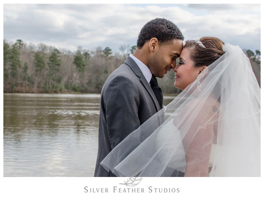 Kim and Wally pose on dock by Bass Lake with NC Wedding Photographer & Videographer