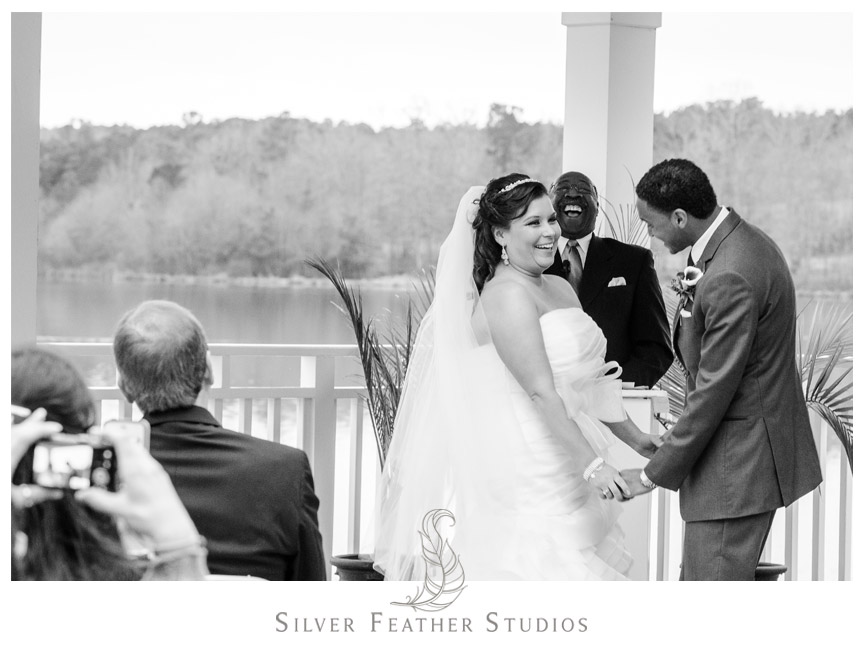 Bride laughs at her Bass Lake Wedding in Holly Spring, North Carolina