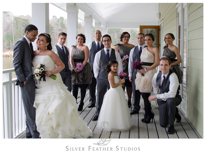 Bridal party pose in gray, beige, and purple at Bass Lake - NC Wedding Videographer and Photographer