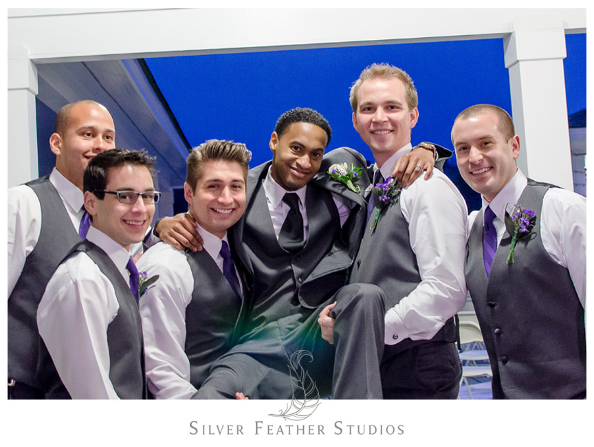 Groomsmen having fun in Holly Springs, North Carolina - NC Wedding Videographer and Photographer.