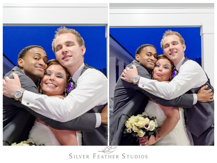 Bride between groom and best man as they hug - NC Wedding Videography and Photography