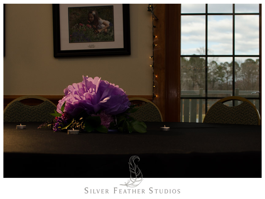 Purple centerpieces at Bass Lake Wedding in Holly Springs, North Carolina.