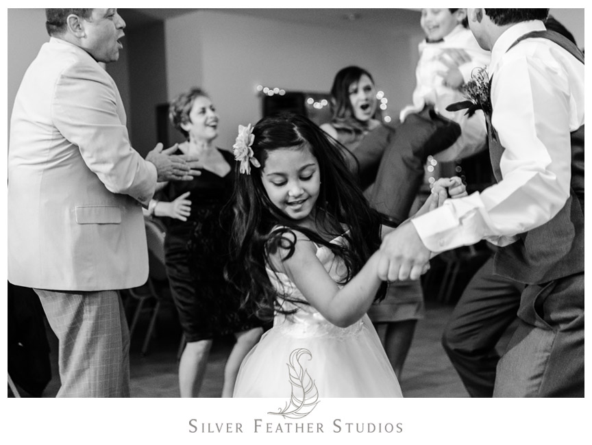 Flower girl dances to music. DJing by Melbourne Entertainment.