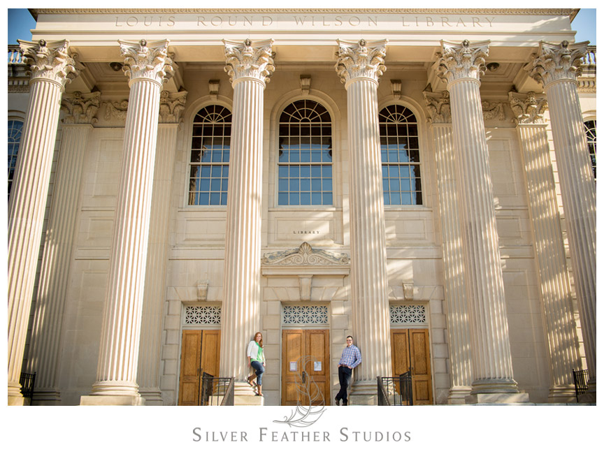 Erin and Adam pose at the Louis Round Wilson Library during their UNC Chapel Hill Engagement Session. © Silver Feather Studios, Chapel Hill Wedding Videography and Photography