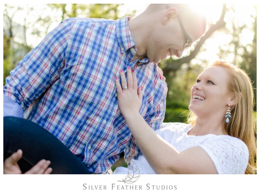 Groom dips his bride to be at their UNC Chapel Hill engagement session. © Silver Feather Studios, Chapel Hill Wedding Photography and Videography