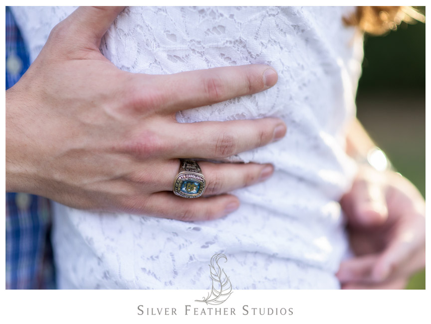 Chapel Hill alum wears his college class ring - go tar heels! Chapel Hill engagement session.  © Silver Feather Studios, Chapel Hill Wedding Photography and Videography