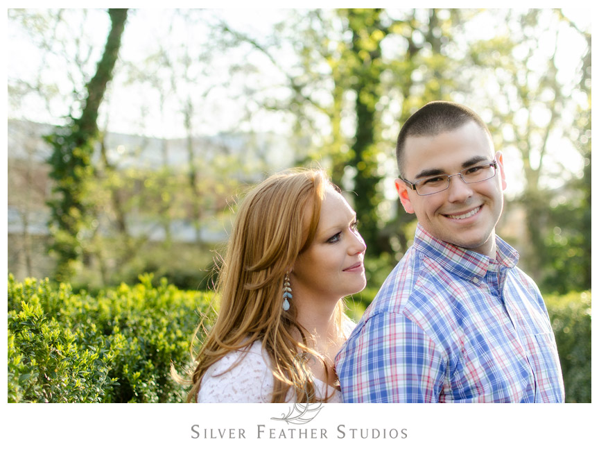 Beautiful pose of Erin and Adam at their spring session at UNC Chapel Hill. © Silver Feather Studios, Chapel Hill Wedding Videography and Photography