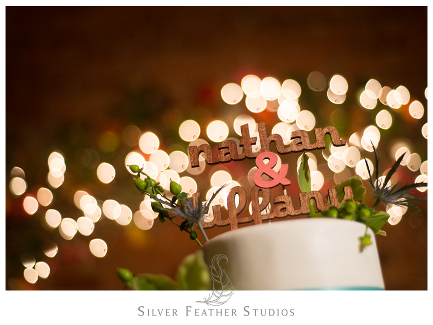 Cake pops against stunning light bokeh at this Cotton Room Wedding. © Silver Feather Studios, Durham Wedding Photography and Videography