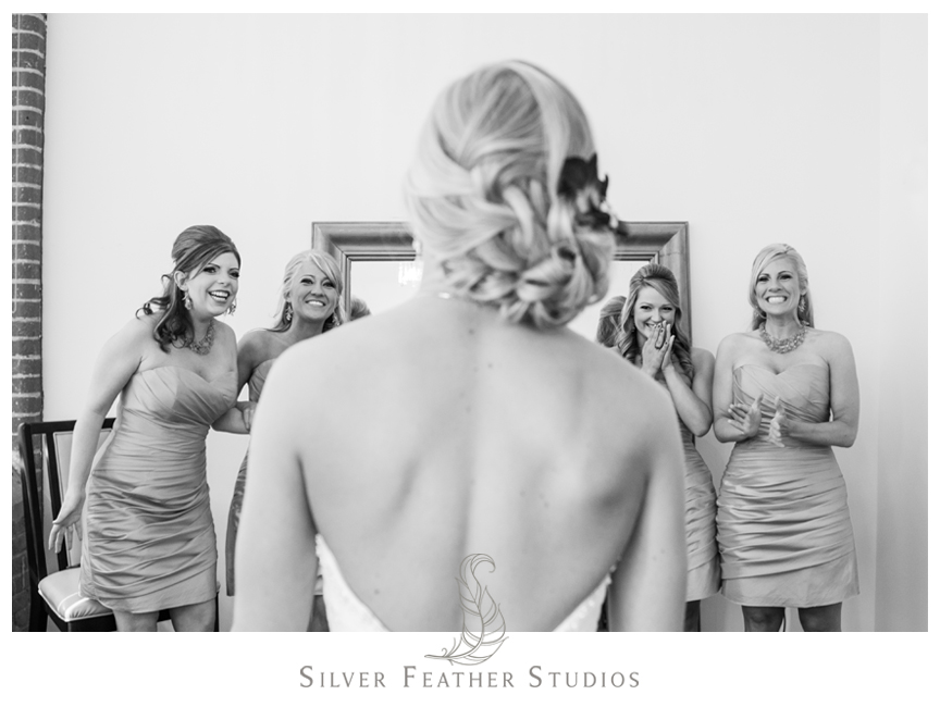 Bridesmaids praise the gorgeous bride at her Cotton Room Wedding. © Silver Feather Studios, Chapel Hill Wedding Photography and Videography