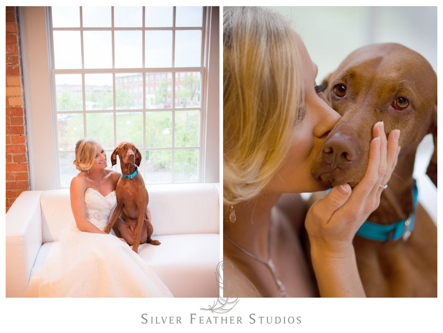 Bride and dog pose at The Cotton Room in Durham, NC.