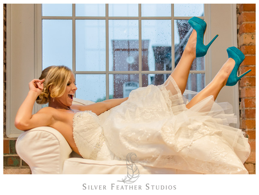 Tiffany kicks her feet up at The Cotton Room. Photography by Silver Feather Studios, Durham Wedding Photography and Video.