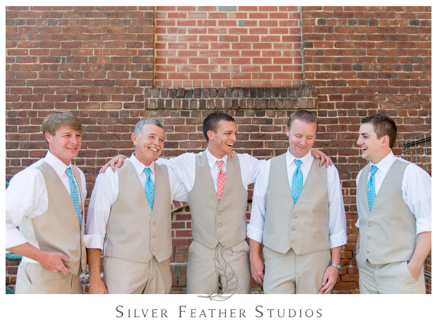 aqua and coral ties with beige vests and pants at the cotton room wedding durham