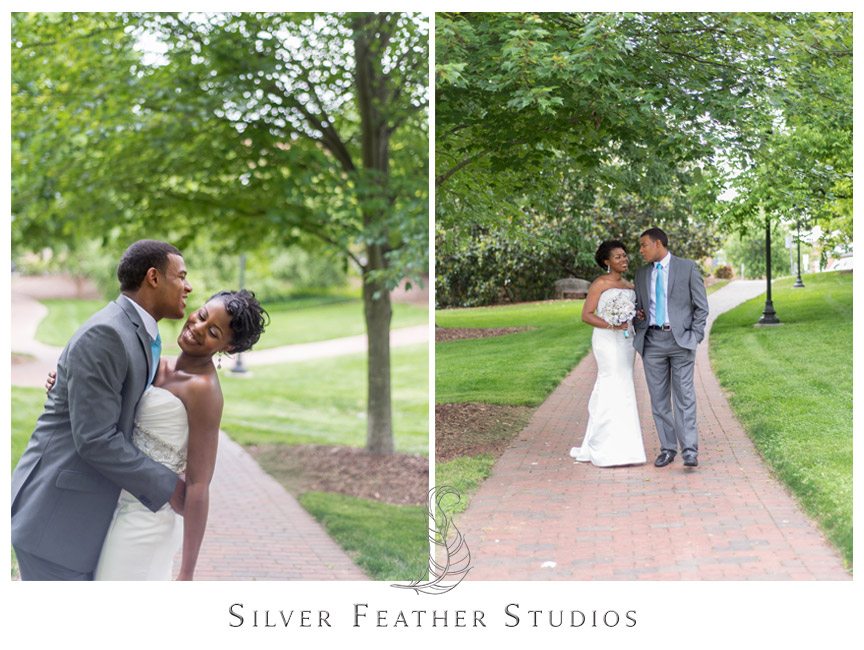 Juliet and Marc pose on the walkways at UNC Greensboro. Photography by Silver Feather Studios.