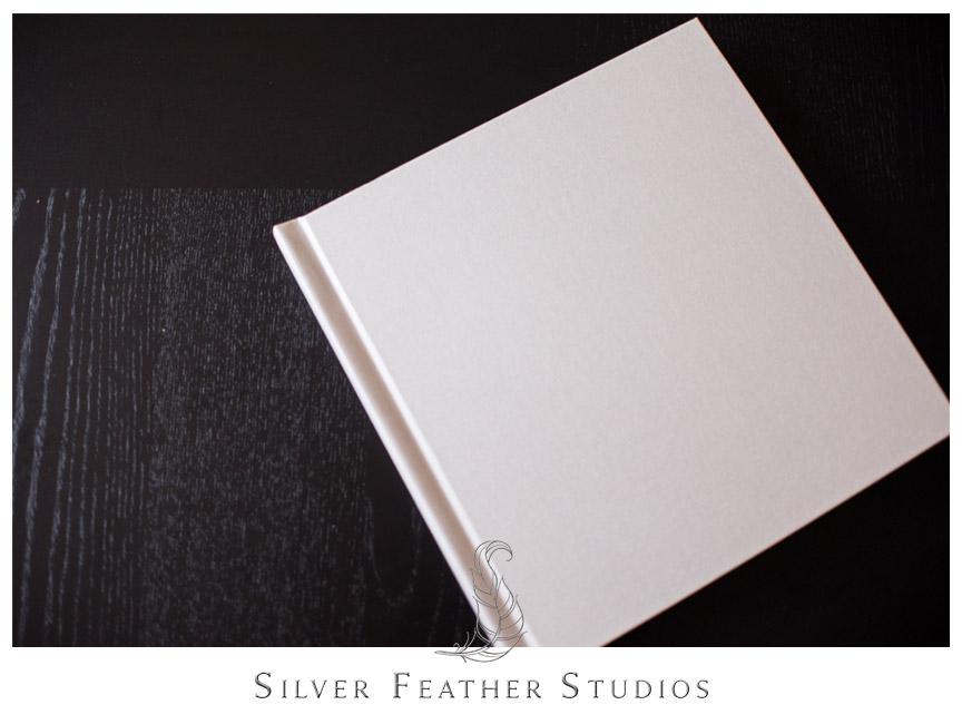 Cream linen bridal album. Photograph by Silver Feather Studios.