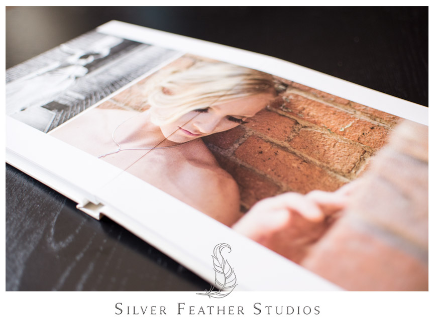 Two image spread inside cream linen bridal album. Photograph by Silver Feather Studios.