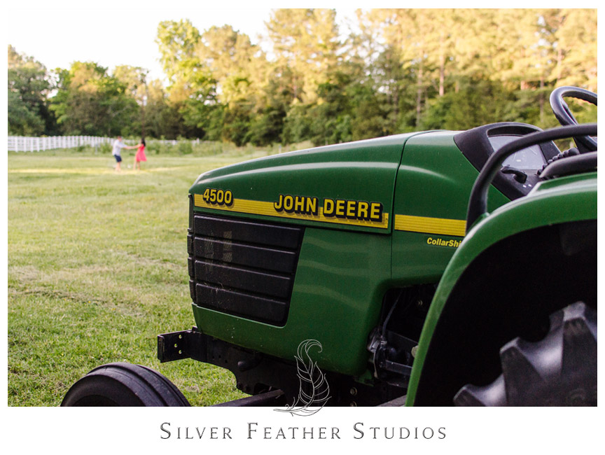Dancing in the fields behind this John Deere tractor in Chapel Hill, North Carolina.