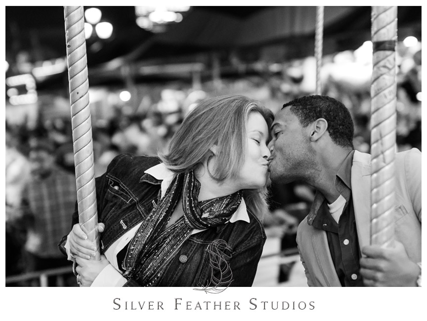 Engagement photo on the carousel at the Raleigh, NC State Fair.