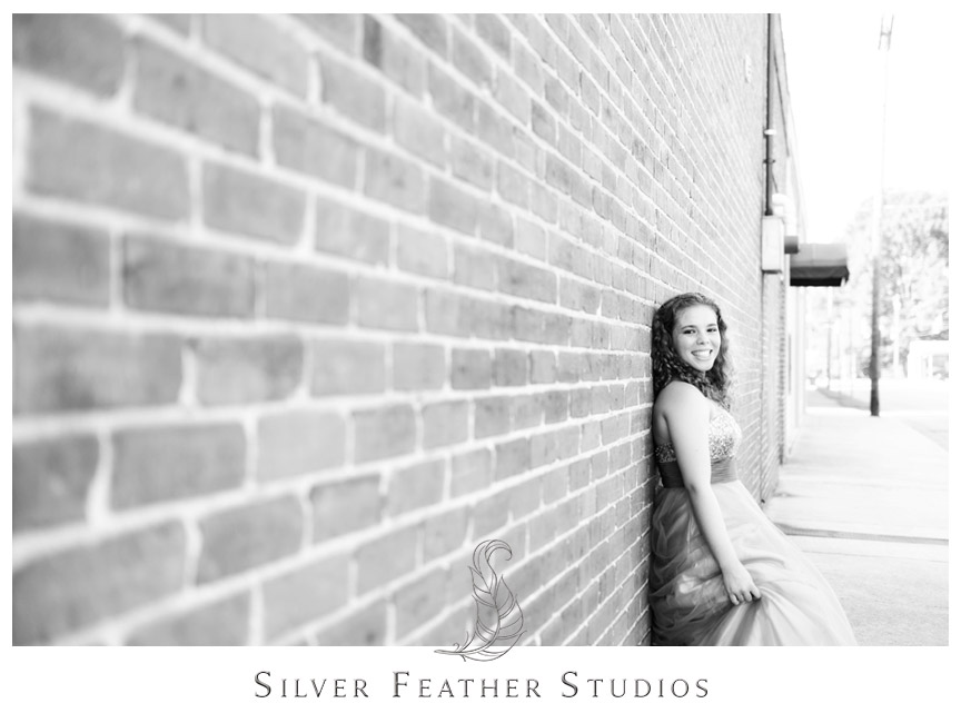 Ariana poses against brick wall in Downtown Gibsonville.
